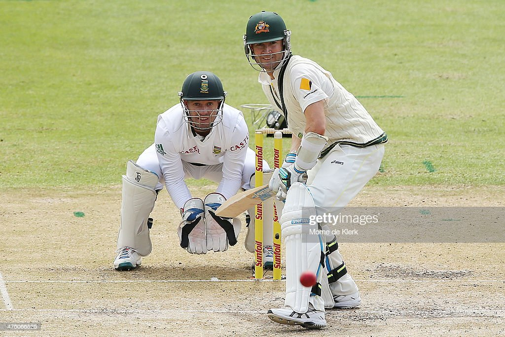 Michael Clarke of Australia bats in front of AB de Villiers of South Africa during day 2 of the third test match between South Africa and Australia at Sahara Park Newlands on March 2, 2014 in Cape Town, South Africa.