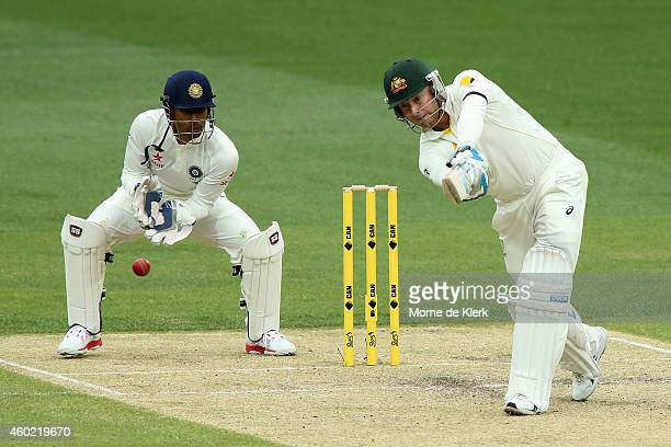 Michael Clarke of Australia bats in front of Wriddhiman Saha of India during day two of the First Test match between Australia and India at Adelaide...