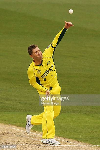 Michael Clarke of Australia bowls during the Cricket World Cup warm up match between Australia and the United Arab Emirates at Melbourne Cricket...