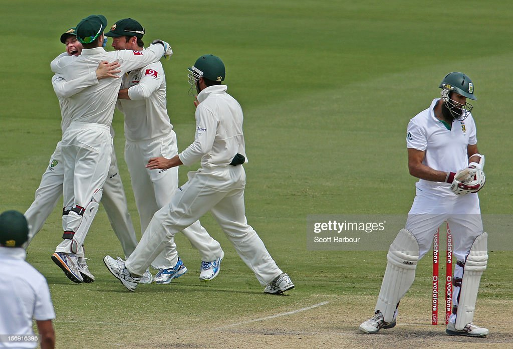 Michael Clarke of Australia celebrates after taking a catch at slip to dismiss Hashim Amla of South Africa during day four of the Second Test Match between Australia and South Africa at Adelaide Oval on November 25, 2012 in Adelaide, Australia.