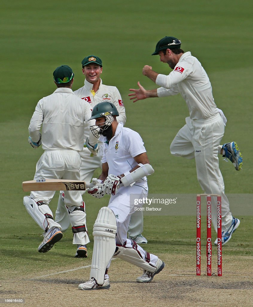 Michael Clarke of Australia celebrates after taking a catch at slip to dismiss <a gi-track='captionPersonalityLinkClicked' href=/galleries/search?phrase=Hashim+Amla&family=editorial&specificpeople=647392 ng-click='$event.stopPropagation()'>Hashim Amla</a> of South Africa during day four of the Second Test Match between Australia and South Africa at Adelaide Oval on November 25, 2012 in Adelaide, Australia.