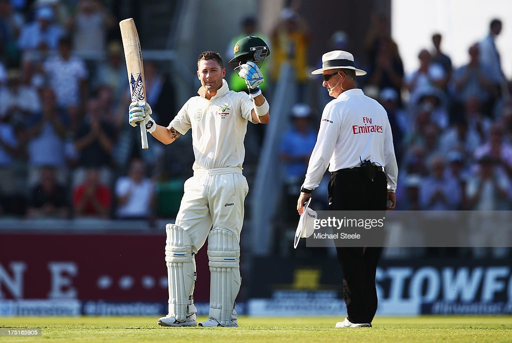 Michael Clarke of Australia celebrates his century watched by umpire Tony Hill during day one of the 3rd Investec Ashes Test match between England and Australia at Old Trafford Cricket Ground on August 1, 2013 in Manchester, England.