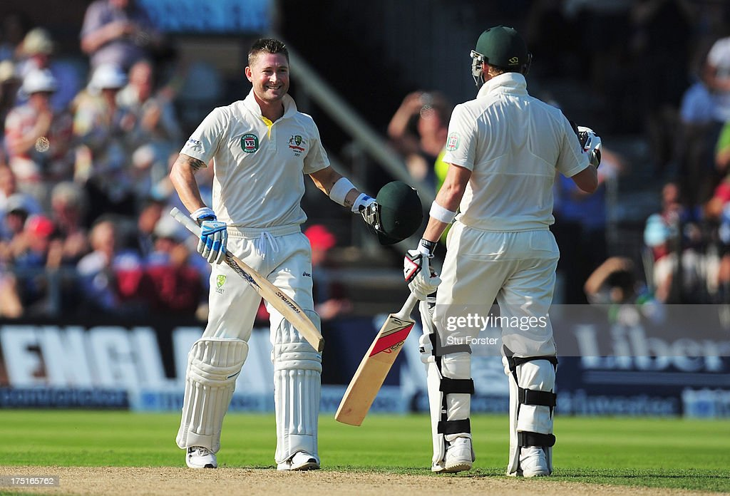 Michael Clarke of Australia celebrates his century with Steve Smith during day one of the 3rd Investec Ashes Test match between England and Australia at Old Trafford Cricket Ground on August 1, 2013 in Manchester, England.