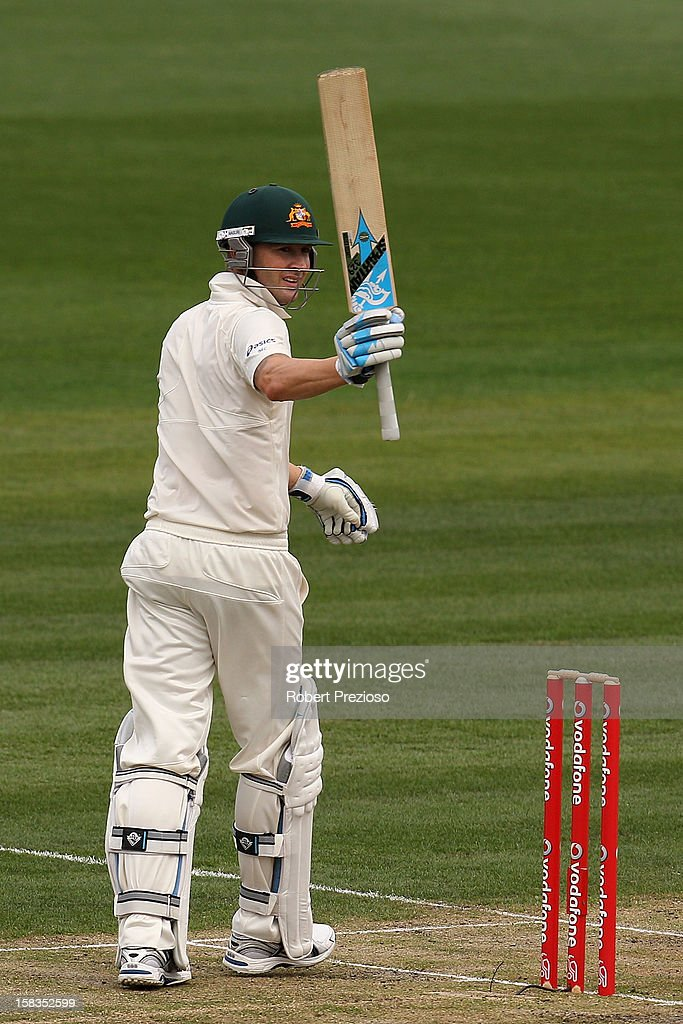 Michael Clarke of Australia celebrates scoring a half century during day one of the First Test match between Australia and Sri Lanka at Blundstone Arena on December 14, 2012 in Hobart, Australia.
