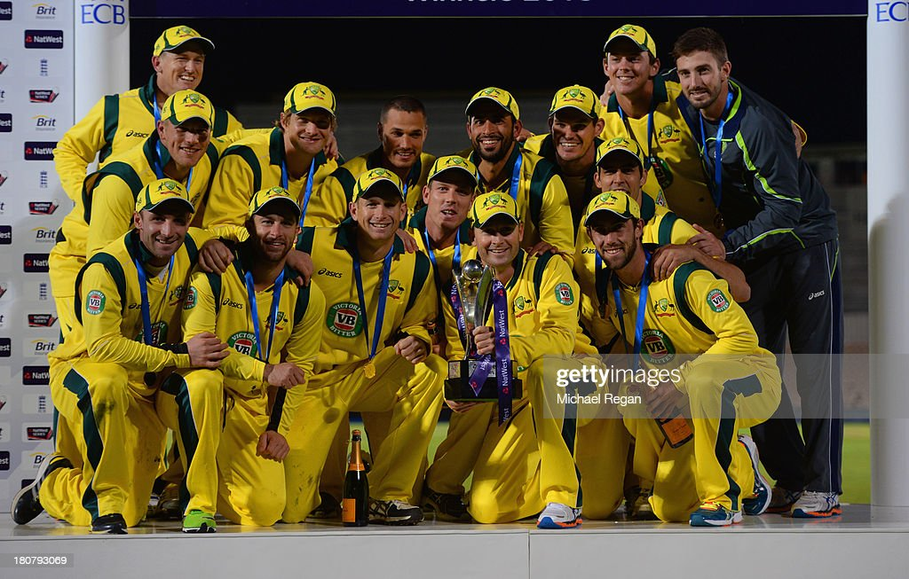 Michael Clarke of Australia celebrates with the series trophy and team mates after the 5th NatWest Series ODI between England and Austalia at the Ageas Bowl on September 16, 2013 in Southampton, England.