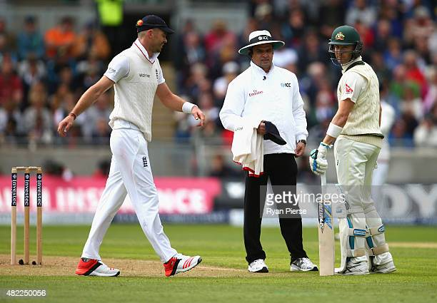 Michael Clarke of Australia exchanges words with James Anderson of England as Umpire Aleem Dar looks on during day one of the 3rd Investec Ashes Test...