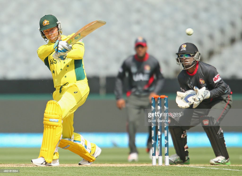 <a gi-track='captionPersonalityLinkClicked' href=/galleries/search?phrase=Michael+Clarke+-+Cricket+Player&family=editorial&specificpeople=175853 ng-click='$event.stopPropagation()'>Michael Clarke</a> of Australia hits a boundary as wicketkeeper Swapnil Patil of the United Arab Emirates looks on during the Cricket World Cup warm up match between Australia and the United Arab Emirates at Melbourne Cricket Ground on February 11, 2015 in Melbourne, Australia.