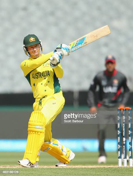 Michael Clarke of Australia hits a boundary during the Cricket World Cup warm up match between Australia and the United Arab Emirates at Melbourne...