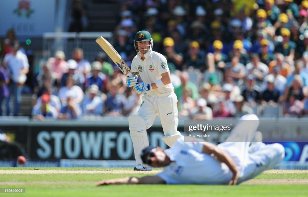 Michael Clarke of Australia hits out past <a gi-track='captionPersonalityLinkClicked' href=/galleries/search?phrase=Alastair+Cook+-+Cricketspeler&family=editorial&specificpeople=571475 ng-click='$event.stopPropagation()'>Alastair Cook</a> of England during day two of the 3rd Investec Ashes Test match between England and Australia at Emirates Old Trafford Cricket Ground on August 2, 2013 in Manchester, England.