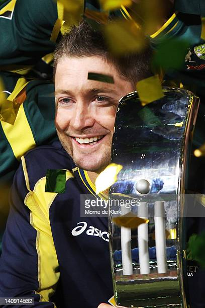 Michael Clarke of Australia holds the Commonwealth Bank series trophy after the third One Day International Final series match between Australia and...