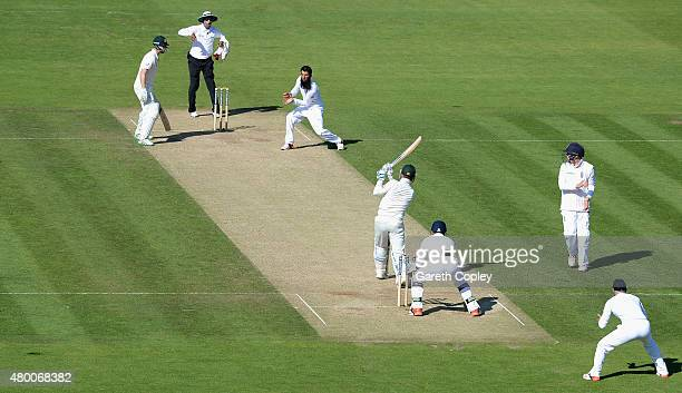 Michael Clarke of Australia is caught out by Moeen Ali of England during day two of the 1st Investec Ashes Test match between England and Australia...