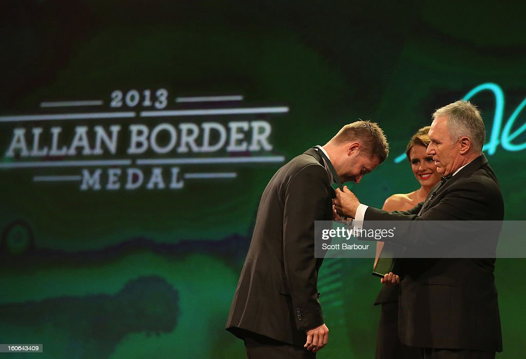Michael Clarke (L) of Australia is presented with the the Allan Border Medal on stage by Allan Border during the 2013 Allan Border Medal awards ceremony at Crown Palladium on February 4, 2013 in Melbourne, Australia.
