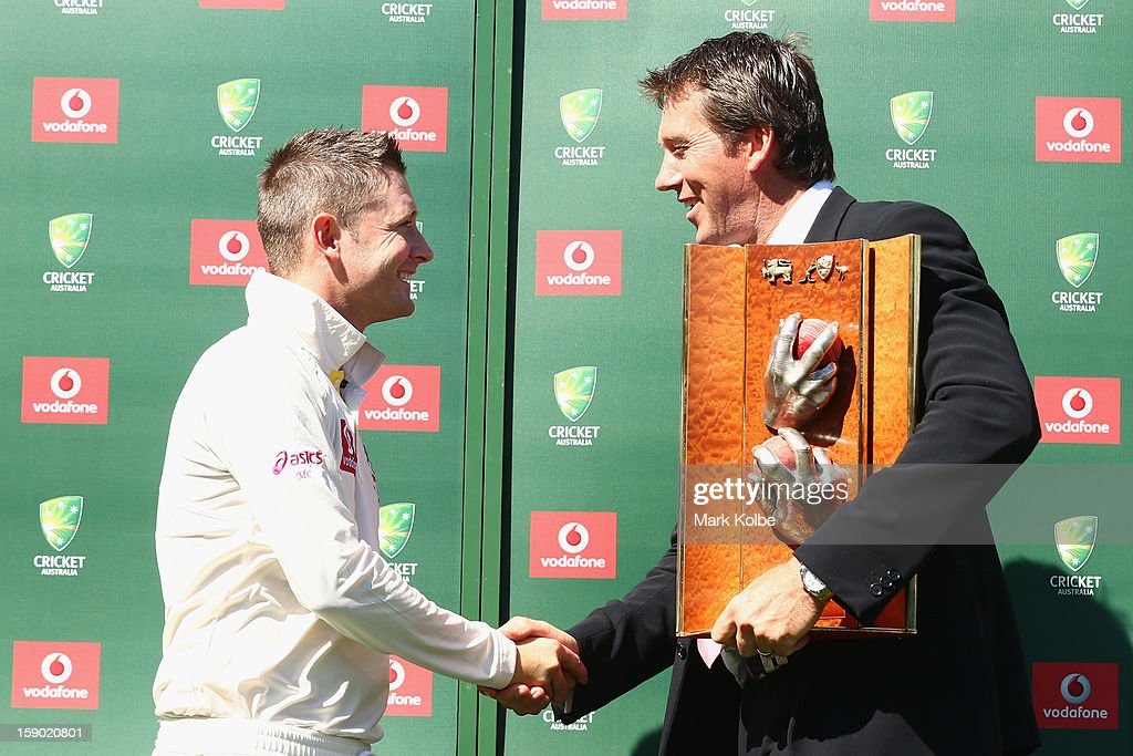 Michael Clarke of Australia is presented with the Warne–Muralidaran trophy by Glenn McGrath after victory on day four of the Third Test match between Australia and Sri Lanka at Sydney Cricket Ground on January 6, 2013 in Sydney, Australia.