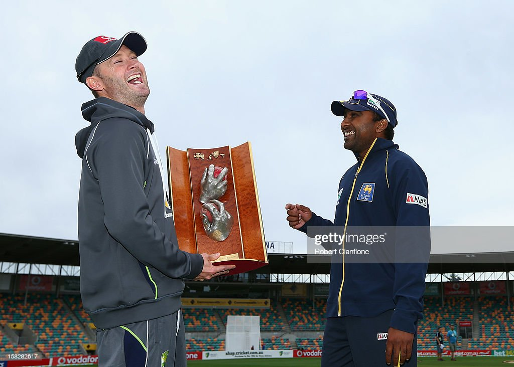 Michael Clarke of Australia laughs with Mahela Jaywardena of Sri Lanka as they pose for the media with the Warne/Murali Trophy after an Australian nets session at Blundstone Arena on December 13, 2012 in Hobart, Australia.