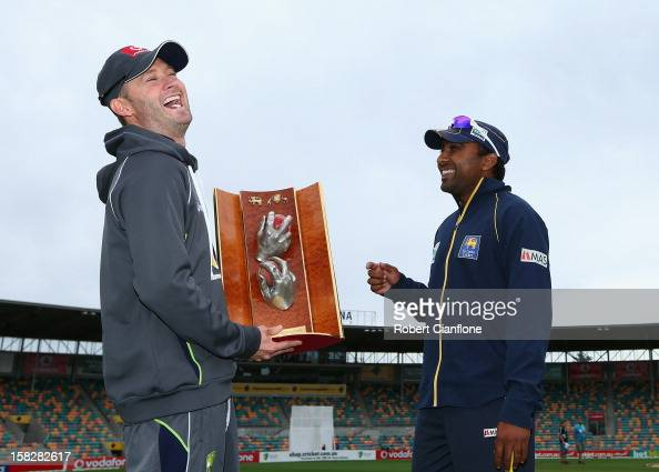 Michael Clarke of Australia laughs with Mahela Jaywardena of Sri Lanka as they pose for the media with the Warne/Murali Trophy after an Australian...