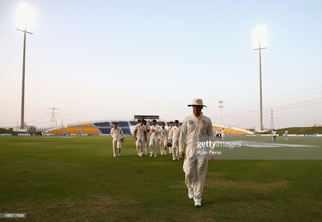 Michael Clarke of Australia leads his team from the field as bad light stopped play during Day Three of the Second Test between Pakistan and Australia at Sheikh Zayed Stadium on November 1, 2014 in Abu Dhabi, United Arab Emirates.