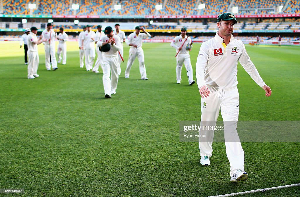 Michael Clarke of Australia leads his team from the ground after the match was drawn during day five of the First Test match between Australia and South Africa at The Gabba on November 13, 2012 in Brisbane, Australia.
