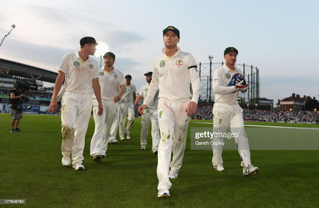 Michael Clarke of Australia leads his team off for bad light during the presentation on day five of the 5th Investec Ashes Test match between England and Australia at the Kia Oval on August 25, 2013 in London, England.