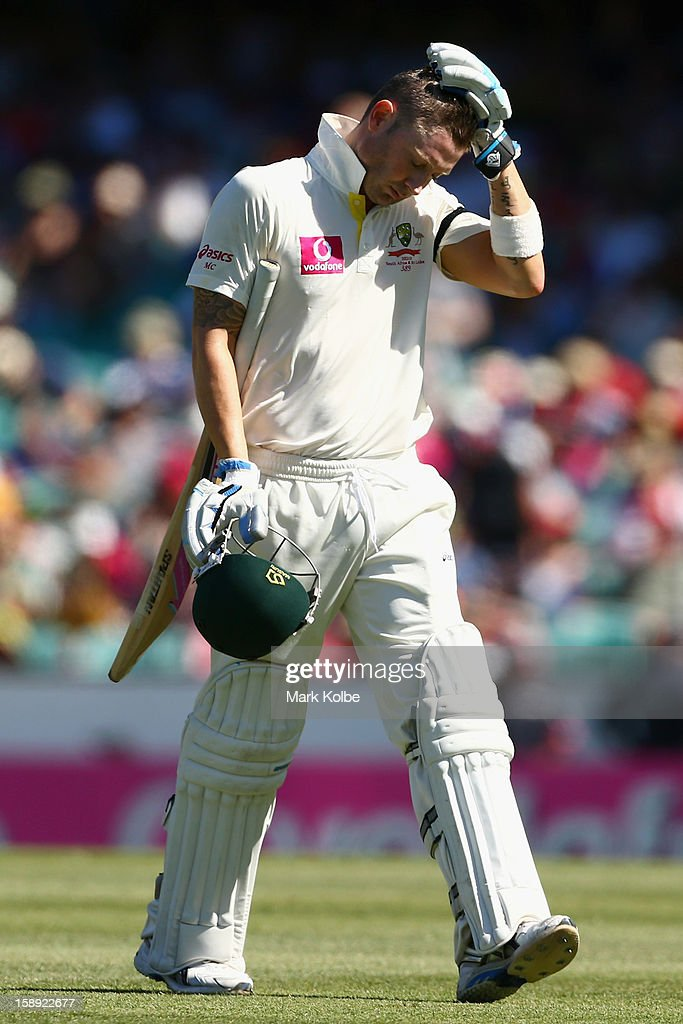 Michael Clarke of Australia looks dejected as he leaves the field after being dismissed during day two of the Third Test match between Australia and Sri Lanka at Sydney Cricket Ground on January 4, 2013 in Sydney, Australia.