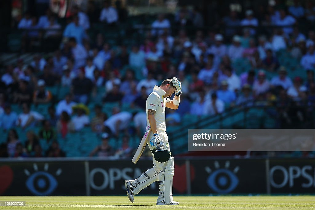 Michael Clarke of Australia looks dejected as he walks off the field after being caught by Dimuth Karunaaratne of Sri Lanka during day two of the Third Test match between Australia and Sri Lanka at Sydney Cricket Ground on January 4, 2013 in Sydney, Australia.