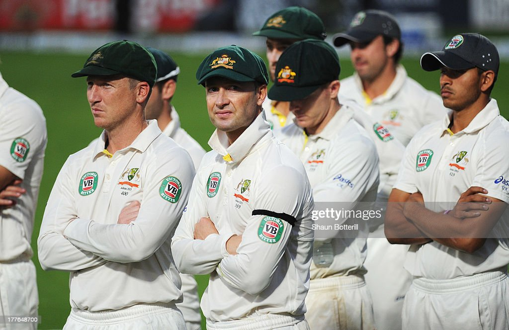 Michael Clarke of Australia looks dejected with team mates during the presentation on day five of the 5th Investec Ashes Test match between England and Australia at the Kia Oval on August 25, 2013 in London, England.