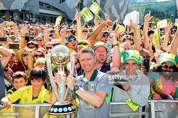 Michael Clarke of Australia poses with the trophy during celebrations after winning the 2015 ICC Cricket World Cup Final at Federation Square on...