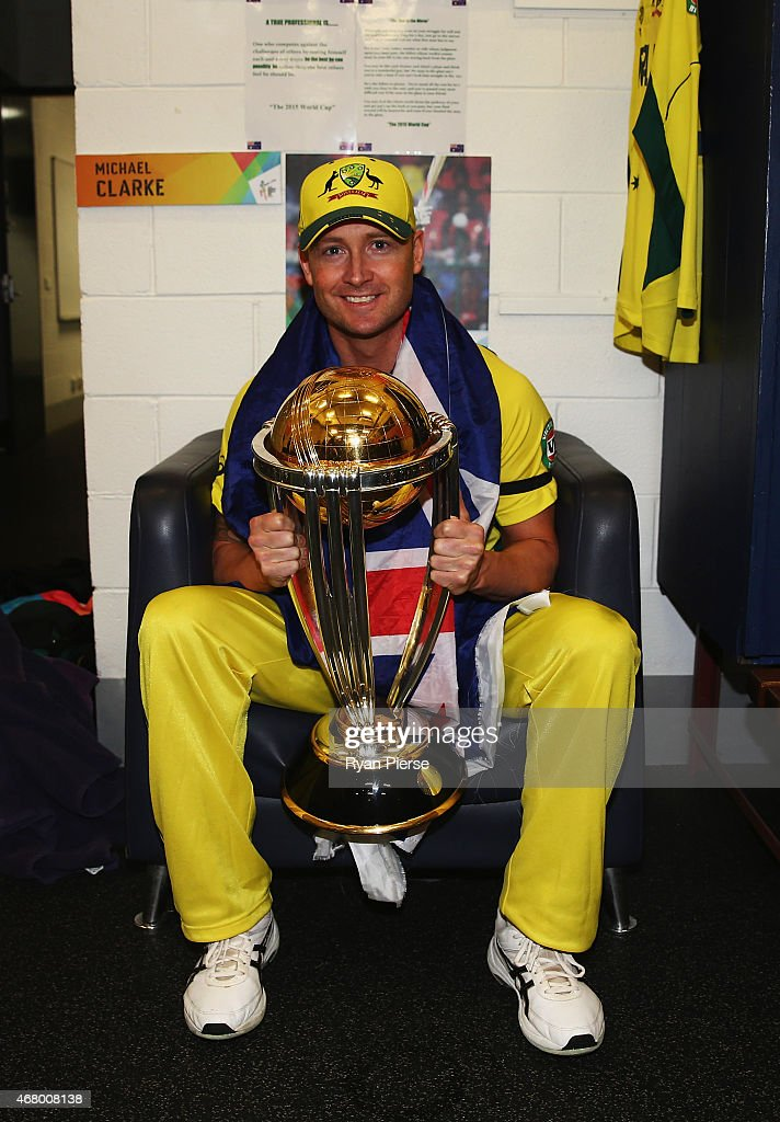 <a gi-track='captionPersonalityLinkClicked' href=/galleries/search?phrase=Michael+Clarke+-+Cricketspeler&family=editorial&specificpeople=175853 ng-click='$event.stopPropagation()'>Michael Clarke</a> of Australia poses with the trophy in the change rooms after the 2015 ICC Cricket World Cup final match between Australia and New Zealand at Melbourne Cricket Ground on March 29, 2015 in Melbourne, Australia.