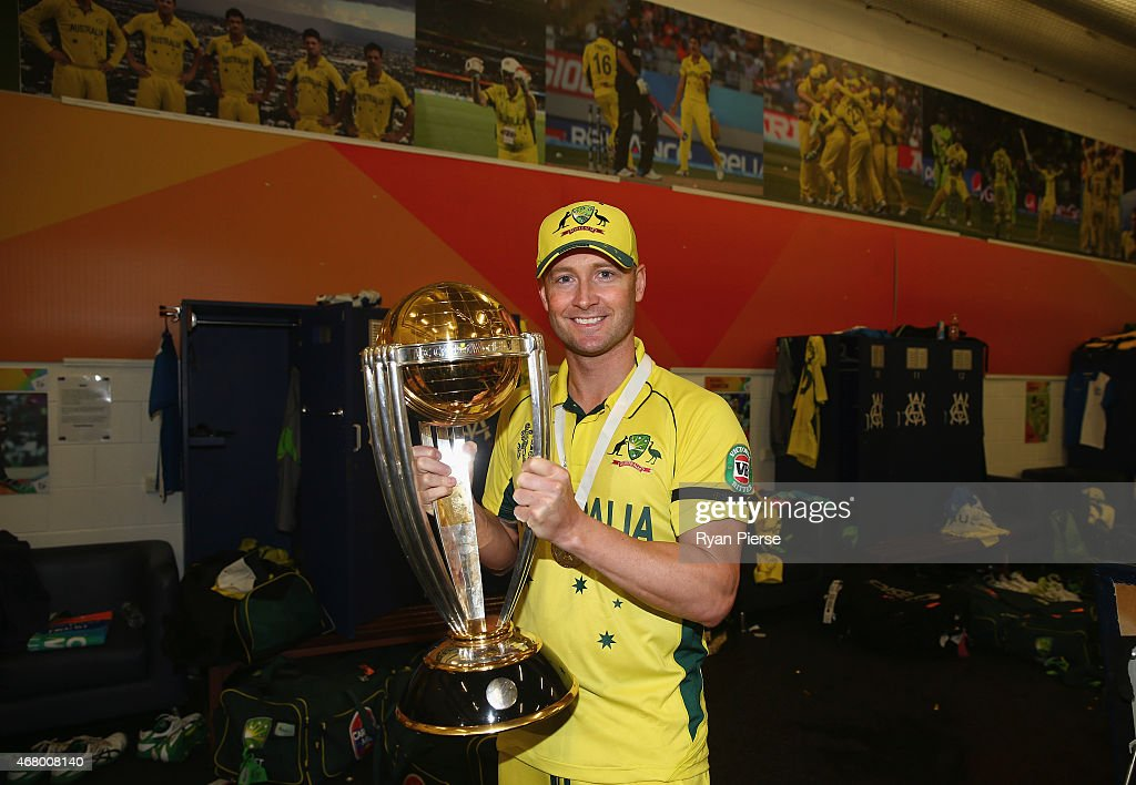 Michael Clarke of Australia poses with the trophy in the change rooms after the 2015 ICC Cricket World Cup final match between Australia and New Zealand at Melbourne Cricket Ground on March 29, 2015 in Melbourne, Australia.