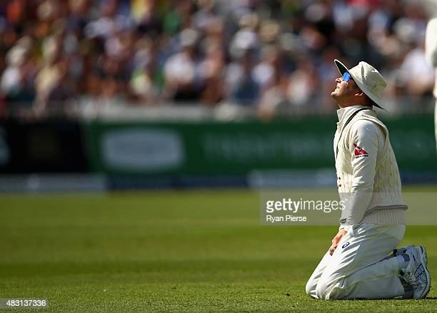 Michael Clarke of Australia reacts after Steve Smith of Australia dropped Alastair Cook of England during day one of the 4th Investec Ashes Test...
