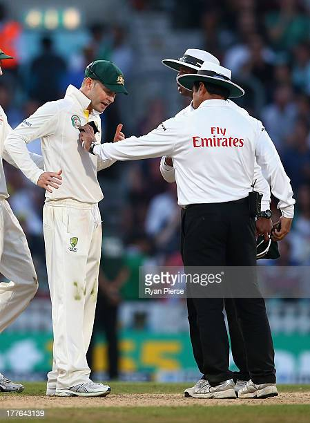 Michael Clarke of Australia remonstrates with Umpire Aleem Dar before bad light ended the match during day five of the 5th Investec Ashes Test match...