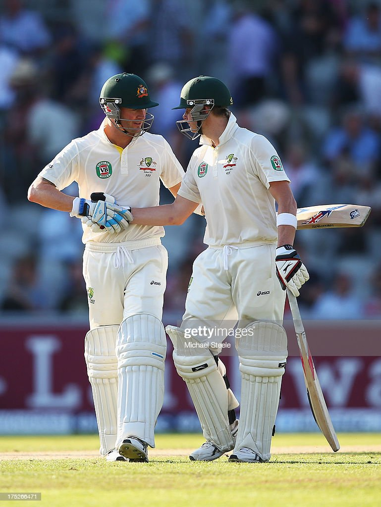 Michael Clarke (L) of Australia shakes hands with Steve Smith as they walk off at the end of play during day one of the 3rd Investec Ashes Test match between England and Australia at Old Trafford Cricket Ground on August 1, 2013 in Manchester, England.