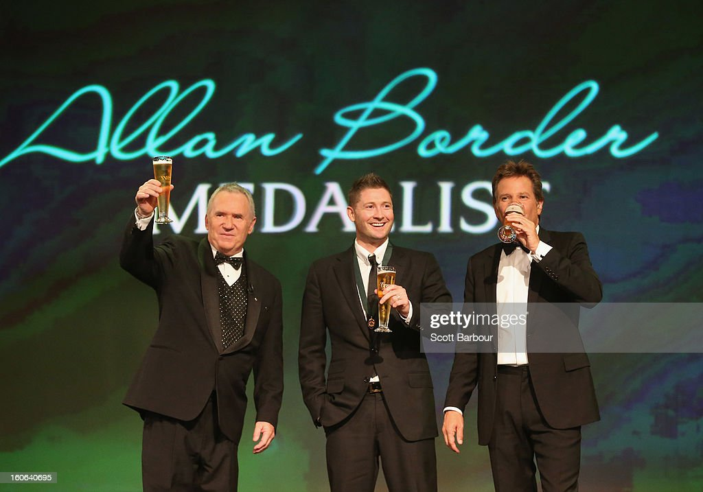 Michael Clarke (C) of Australia shares a toast with Allan Border and Mark Nicholas on stage after winning the Allan Border Medal during the 2013 Allan Border Medal awards ceremony at Crown Palladium on February 4, 2013 in Melbourne, Australia.