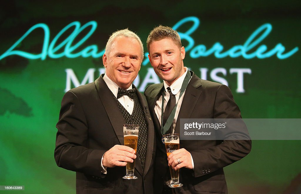 Michael Clarke (R) of Australia shares a toast with Allan Border on stage after winning the Allan Border Medal during the 2013 Allan Border Medal awards ceremony at Crown Palladium on February 4, 2013 in Melbourne, Australia.