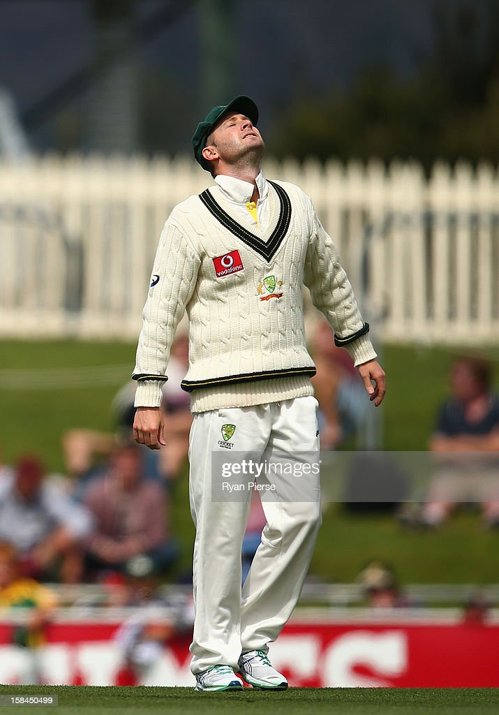 Michael Clarke of Australia shows discomfort while fielding during day four of the First Test match between Australia and Sri Lanka at Blundstone Arena on December 17, 2012 in Hobart, Australia.
