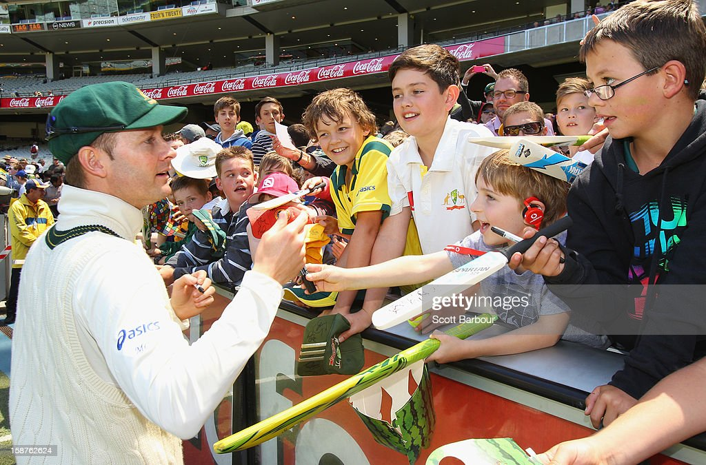 Michael Clarke of Australia signs autographs for fans during day three of the Second Test match between Australia and Sri Lanka at Melbourne Cricket Ground on December 28, 2012 in Melbourne, Australia.