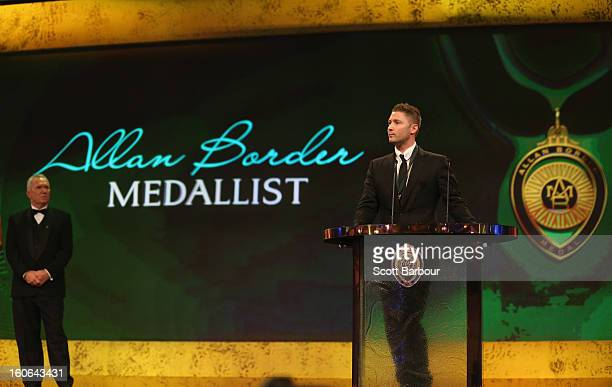 Michael Clarke of Australia speaks after winning the Allan Border Medal as Allan Border looks on during the 2013 Allan Border Medal awards ceremony...