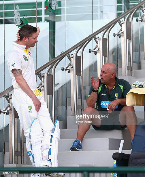 Michael Clarke of Australia speaks to Darren Lehmann coach of Australia during Day Two of the Second Test between Pakistan and Australia at Sheikh...