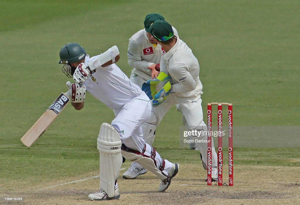 Michael Clarke of Australia takes a catch at slip to dismiss Hashim Amla of South Africa during day four of the Second Test Match between Australia and South Africa at Adelaide Oval on November 25, 2012 in Adelaide, Australia.