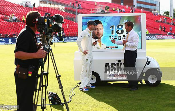 Michael Clarke of Australia talks to Ian Ward at the Sky Sports analysis board after day two of the 3rd Investec Ashes Test match between England and...