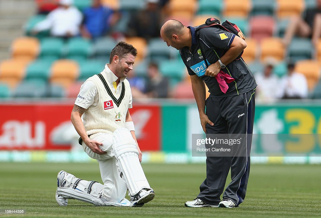 Michael Clarke of Australia talks with physiotherapist Alex Kountouris during day four of the First Test match between Australia and Sri Lanka at Blundstone Arena on December 17, 2012 in Hobart, Australia.
