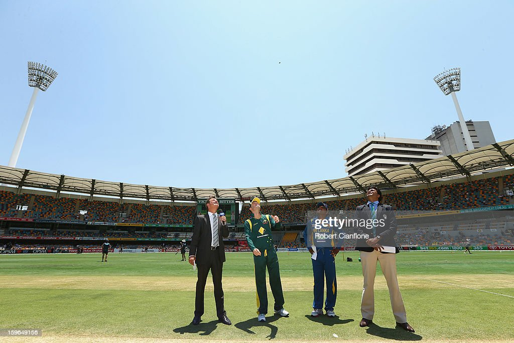 Michael Clarke of Australia tosses the coin prior to game three of the Commonwealth Bank One Day International Series between Australia and Sri Lanka at The Gabba on January 18, 2013 in Brisbane, Australia.