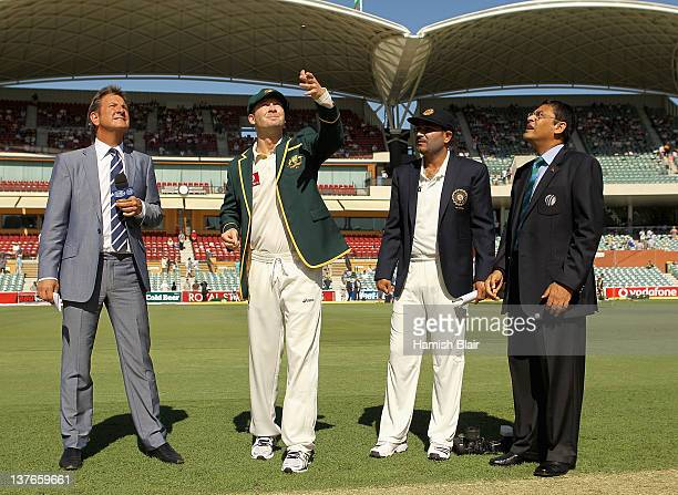 Michael Clarke of Australia tosses the coin with Virender Sehwag of India looking on ahead of day one of the Fourth Test Match between Australia and...