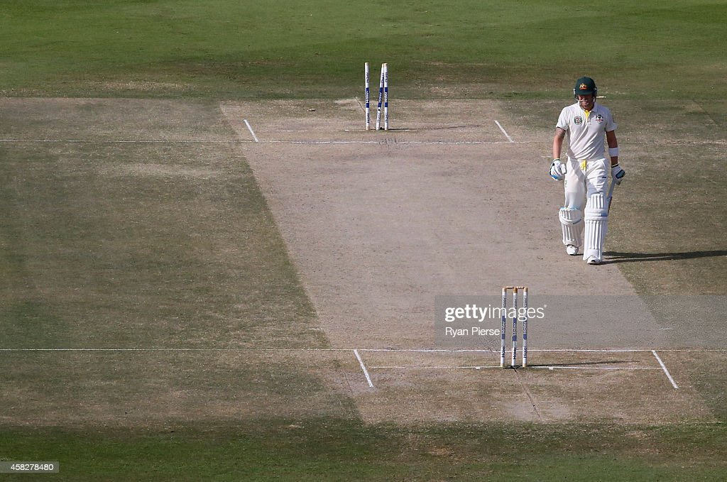 Michael Clarke of Australia walks from the ground after being dismissed by Zulfiqar Babar of Pakistan during Day Four of the Second Test between Pakistan and Australia at Sheikh Zayed Stadium on November 2, 2014 in Abu Dhabi, United Arab Emirates.