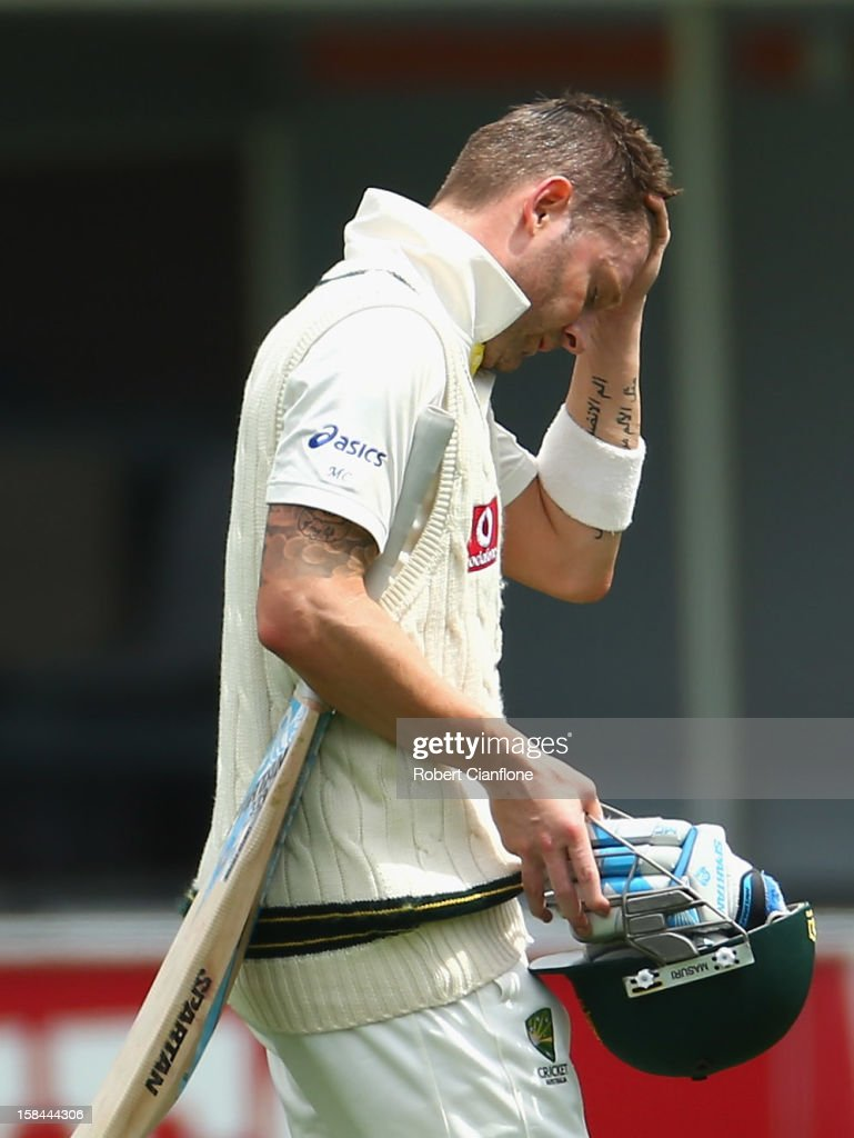 Michael Clarke of Australia walks from the ground retired hurt during day four of the First Test match between Australia and Sri Lanka at Blundstone Arena on December 17, 2012 in Hobart, Australia.