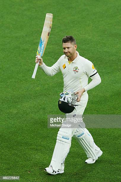 Michael Clarke of Australia walks off due to a rain delay after making his century during day two of the First Test match between Australia and India...