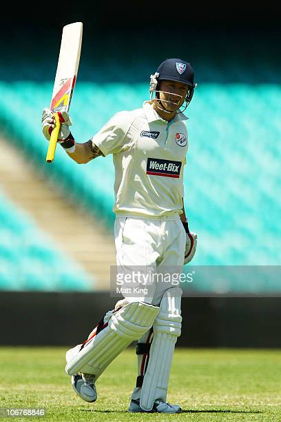 Michael Clarke of the Blues celebrates scoring a century during day three of the Sheffield Shield match between the New South Wales Blues and the...