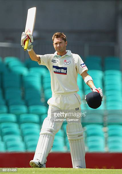 Michael Clarke of the Blues celebrates scoring a century during day two of the Sheffield Shield match between the New South Wales Blues and the...