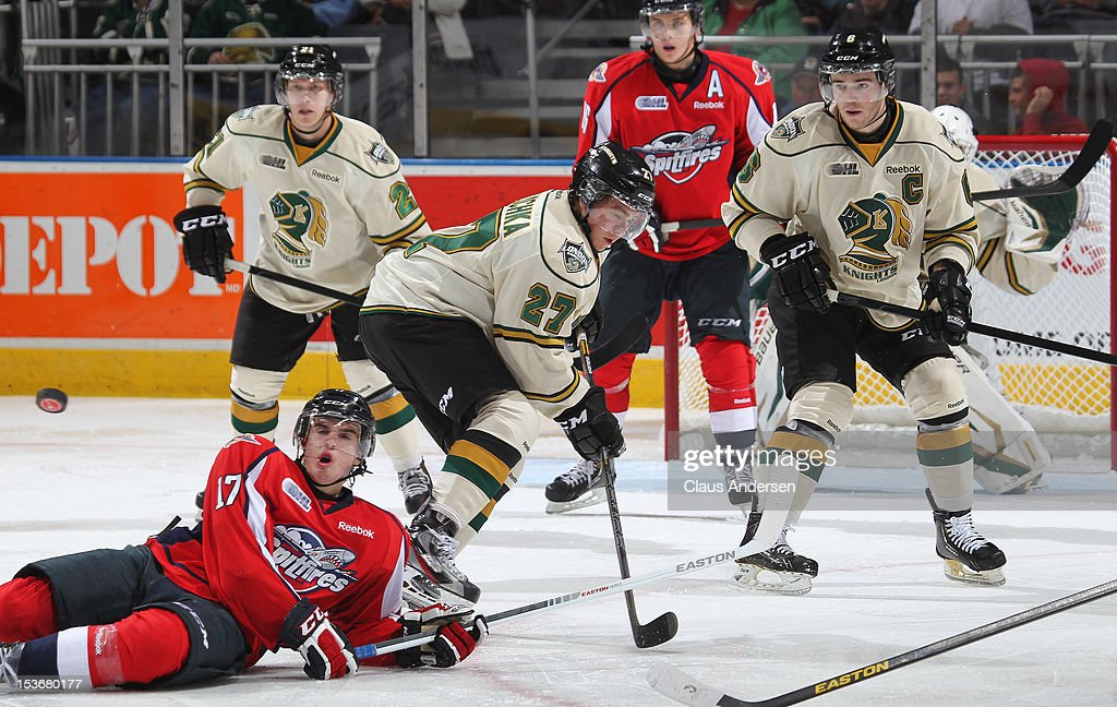 Michael Clarke #17 of the Windsor Spitfires gets hit by a puck in an OHL game against the London Knights on October 5, 2012 at the Budweiser Gardens in London, Canada. The Knights defeated the Spitfires 8-2.