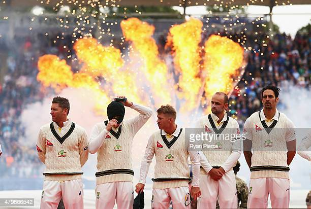 Michael Clarke Steve Smith David Warner Nathan Lyon and Mitchell Johnson of Australia look on during the opening ceremony during the during day one...