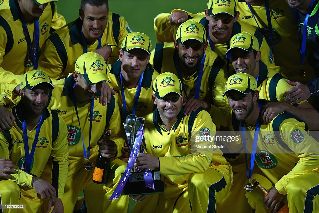 Michael Clarke the captain of Australia and team celebrate their sides 2-1 series victory during the 5th NatWest Series ODI between England and Australia at the Ageas Bowl on September 16, 2013 in Southampton, England.